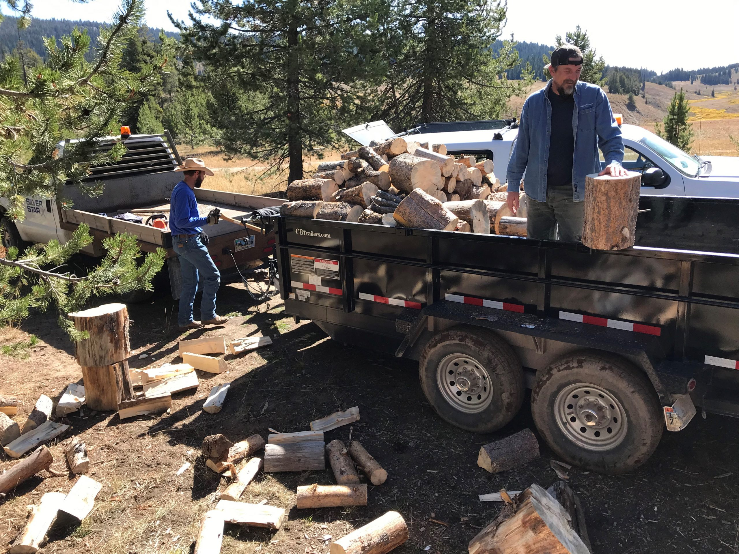 Silver Star Team Members load firewood