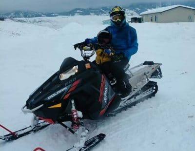 Ben on a snowmobile