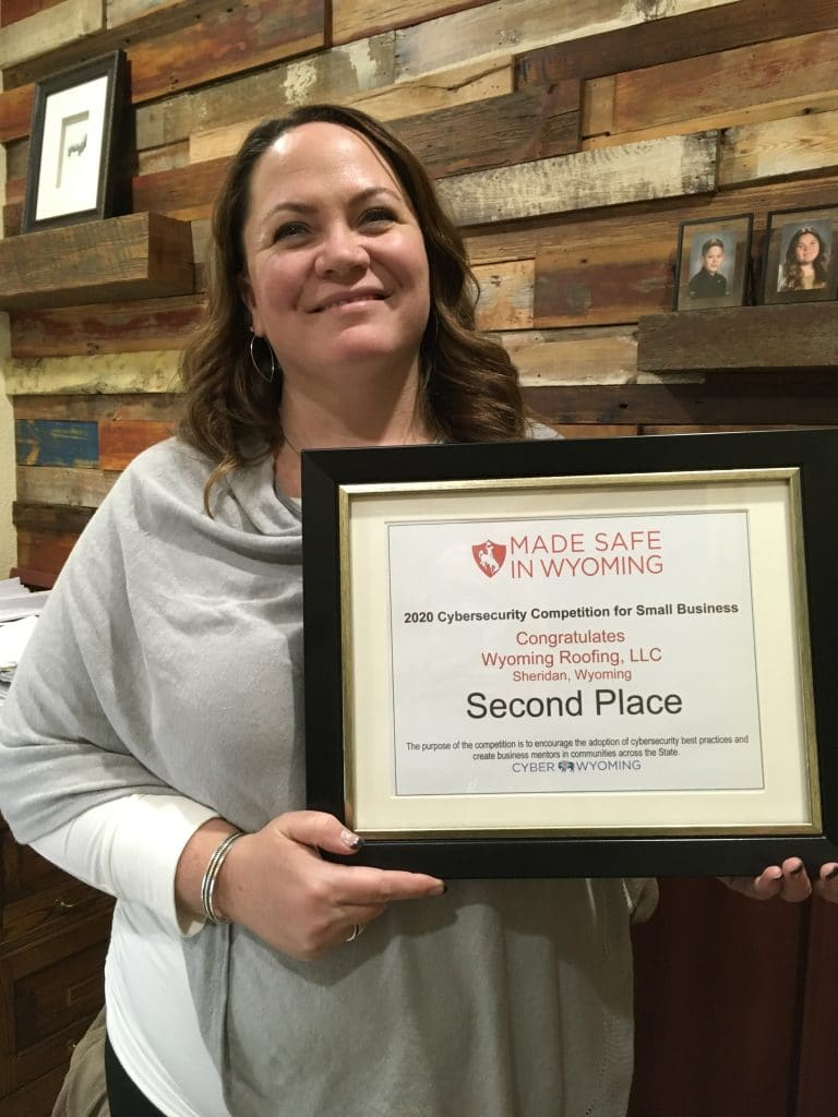 Kelly Hahn, HR Director for Wyoming Roofing LLC with her Second Place 2020 Cybersecurity Competition for Small Businesses certificate.