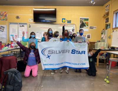 GAP! Girls Actively Participating Group Photo around a Silver Star banner