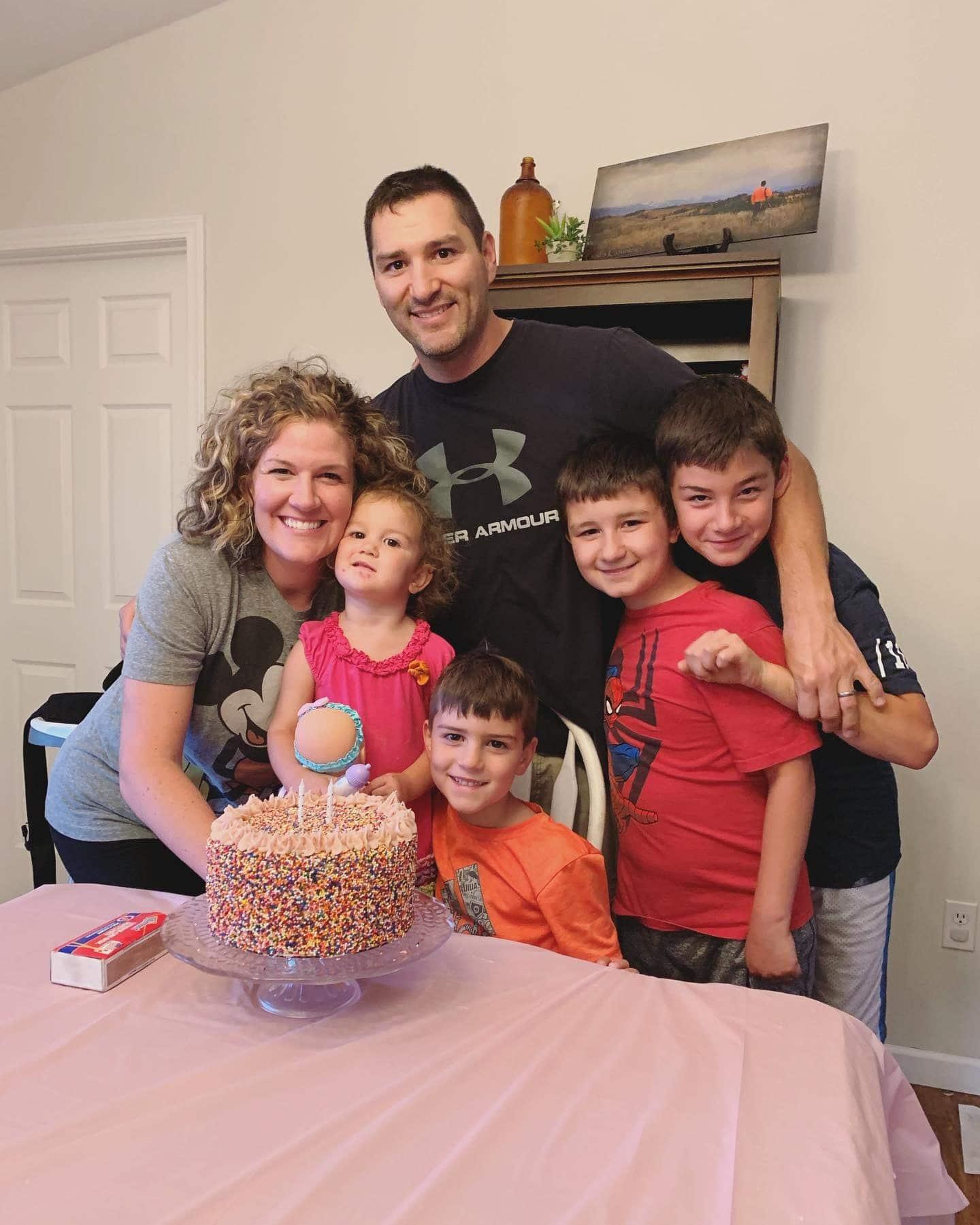 Joaquin and his family around a birthday cake