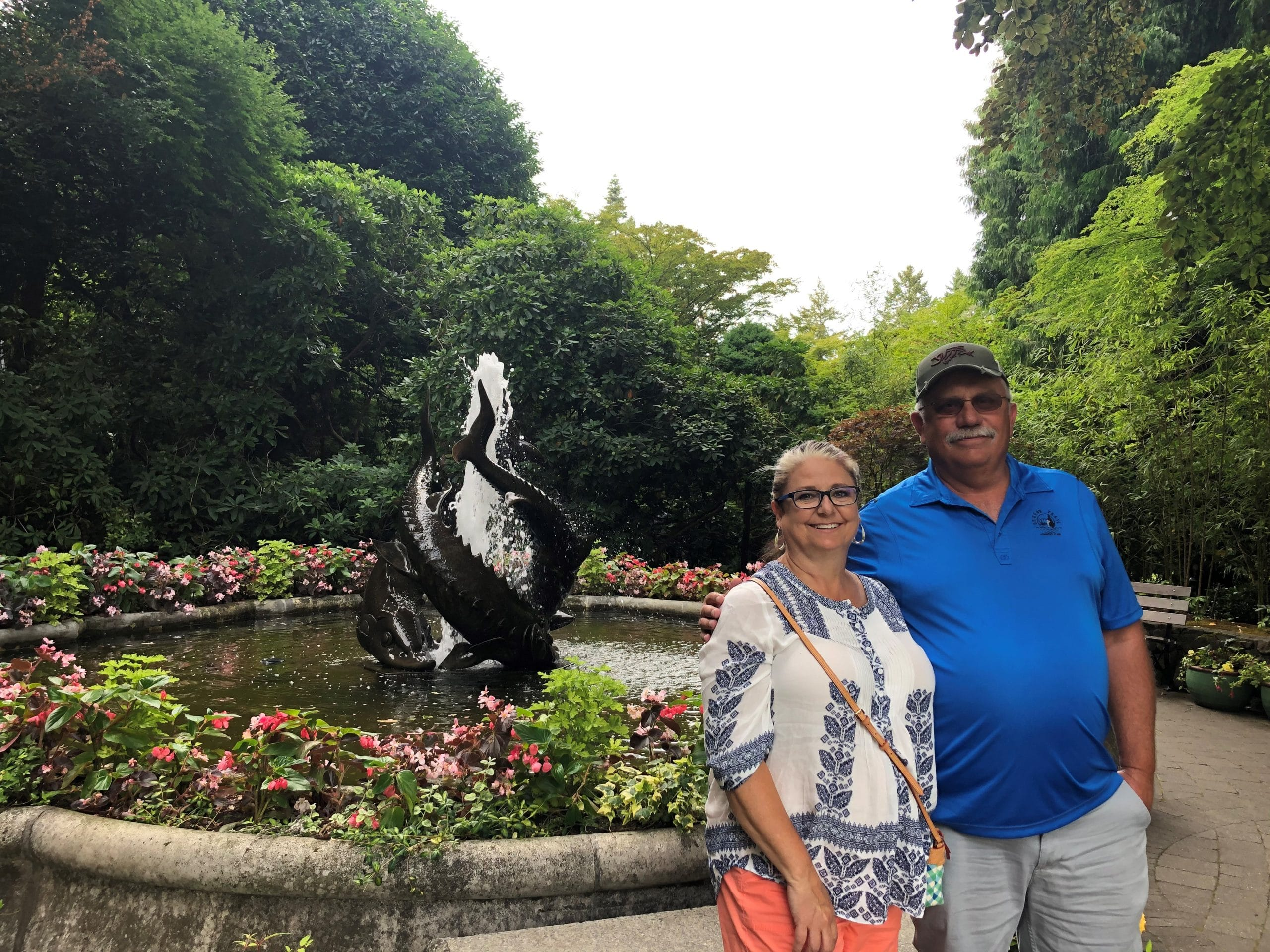 NIcky and her husband with a fountain